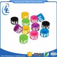 Cheap custom colorful embossed logo printed silicone finger ring size