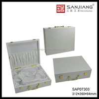 Delicate and elegant white wooden cosmetic box with silk