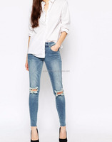 China Wholesale Busted Knee Skinny Jeans Mid Waist Distressed Stretch Denim Jeans