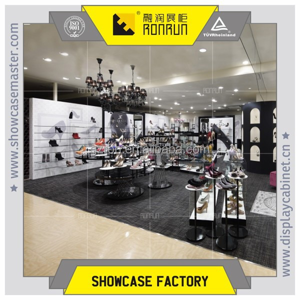 Fashion lady high heeled shoes and boots display showcase, woman shoe shop design