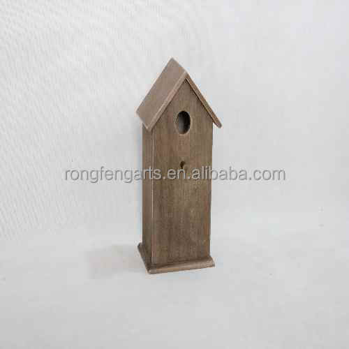 wooden bird nest like a house