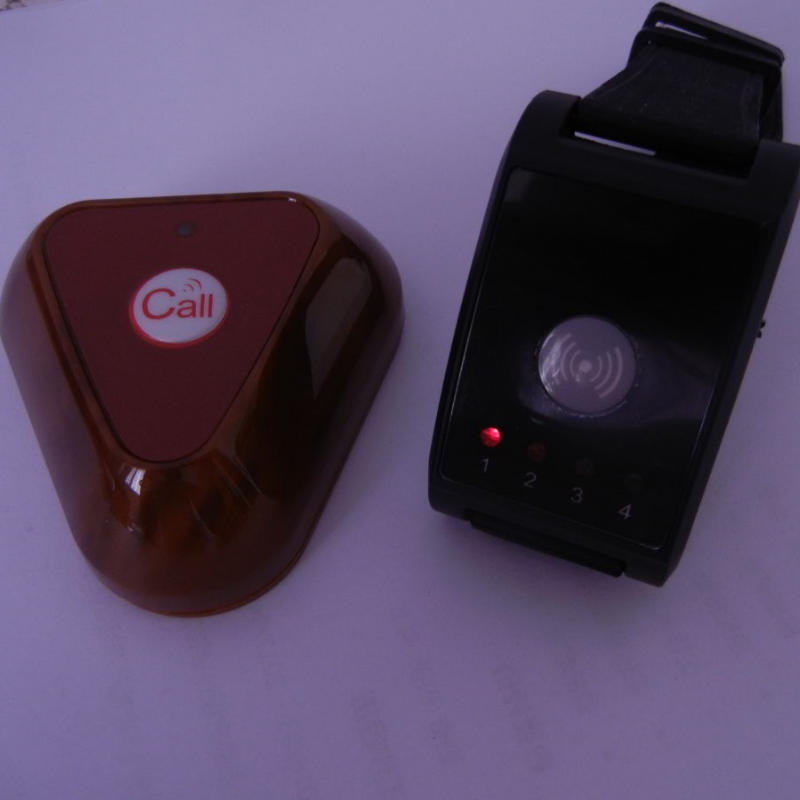 Wireless watch paging system for restaurant