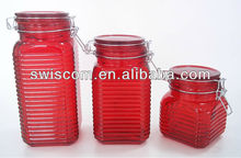 red glass storage jar with glass lid and metal clip