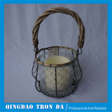 Gray weaved basket with glass and candle