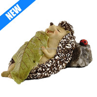 sleeping hedgehog small gnome figurines with leaf blanket statue