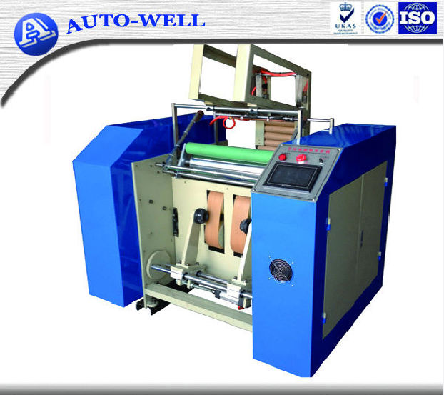 Semi-automatic jumbo roll film slit and rewind machine