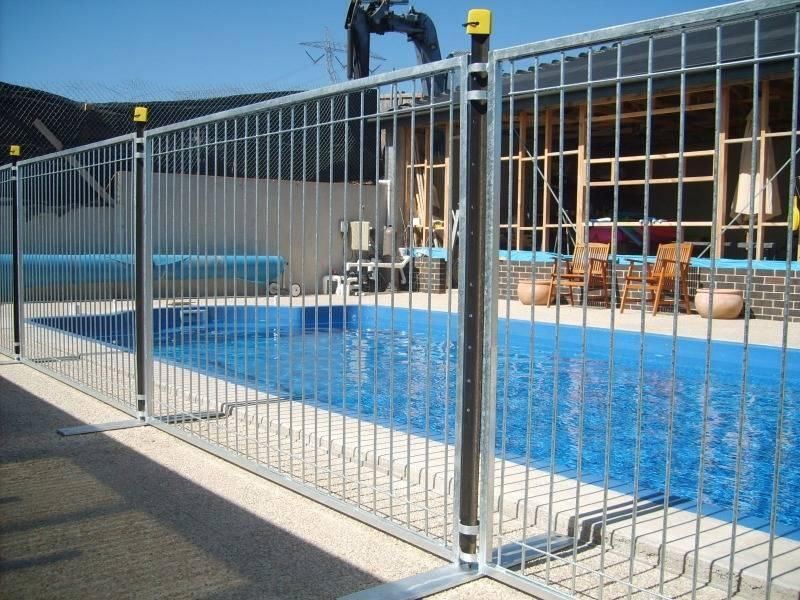Temporary portable safety swimming pool fence view
