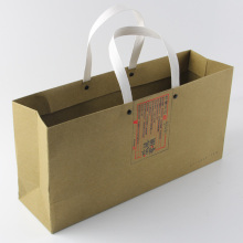 wholesale christmas print logo cosmetic brown craft paper shopping bag with handle