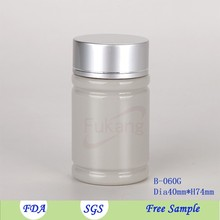 60cc OEM blue / gray / amber color PET plastic round bottle packaging lighten skin pill with aluminum lid