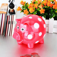 plastic piggy bank with dots