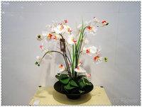 Decorative potted white orchid flower - artificial arrangement