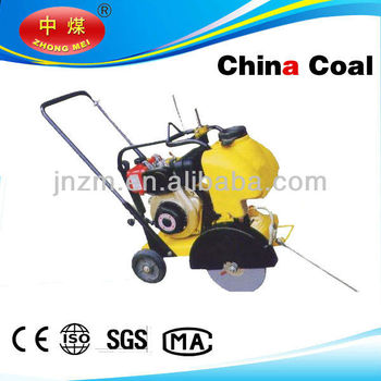 Asphalt and concrete cutter machine