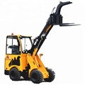 hydraulic compact loader with log grabber