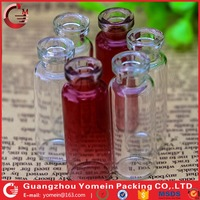 tubular glass vial for hair ampoule with temparent red paint colors.