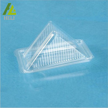Folded clear plastic triangle cake container
