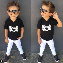 Children's foreign trade European and American summer boy black T-shirt + white pants two pieces
