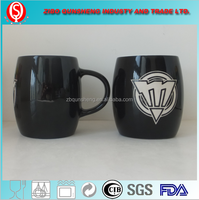 ceramic mug with carved brand logo & with balck glaze