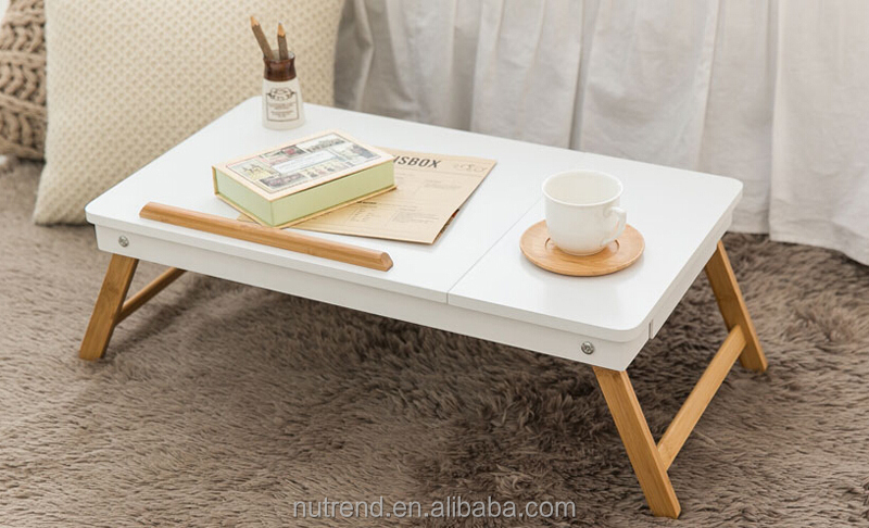 Simple cheap wooden laptop desk with folding leg on bed or sofa