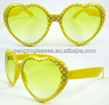 heart shaped plastic sunglasses with white dots on the frame