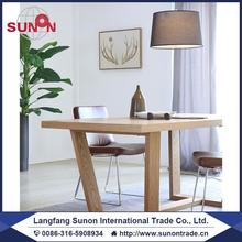wooden dining table and dining chairs