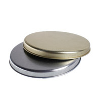 small round tin can lids