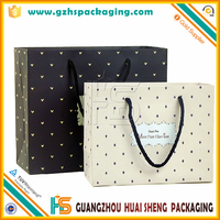 Wholesale Custom Gift Paper Bag with Pp Handle and Ribbon in China