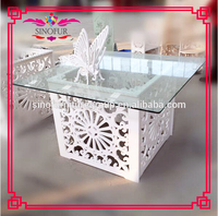 Brand new Qingdao Sinofur knock down glass top wedding table
