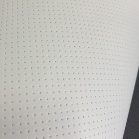 Punched white perforated leather fabric