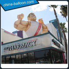 Giant inflatable muscle man model for roof decoration and health club promotion