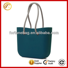 Generous green rubber beach bag with two handles