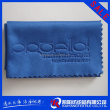 Emboss printed electronics cleaning cloth with serrated edges