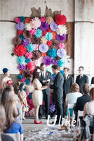 colorful tissue paper fan flowers for wedding stage decoration