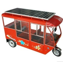Steering wheel electric tricycle with solar panel on roof