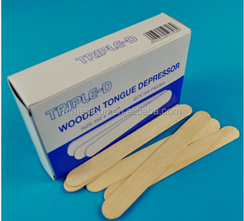 Wooden tongue depressor used for oral examination