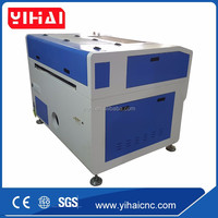 Best price in Jinan China double head wood acrylic bamboo cnc laser engraving and cutting machine 6090