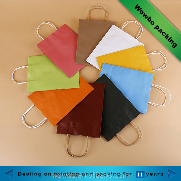 Small solid color kraft paper gift bags with paper twist handle