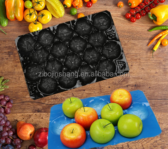 Colored fruit and vegetable packaging tray with different holes and sizes