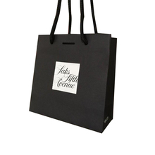 Fashion cheap custom printing design branded slogan black paper shopping bag
