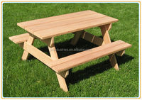 wooden outdoor picnic table and bench