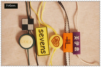 Plastic string lock tag for garments