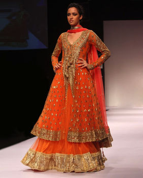 Orange silk hand embroidered lehenga choli