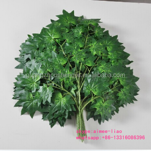 green plastic maple tree branches and leaves