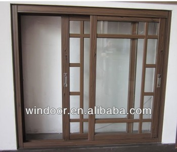 Grill design aluminum sliding window factory wood color for Sliding wooden window design
