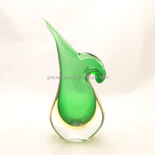 Green greek style blown glass flower bottle