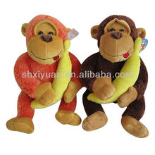 Cute plush toy monkey with banana