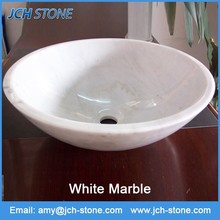 White marble traditional round hand wash basin