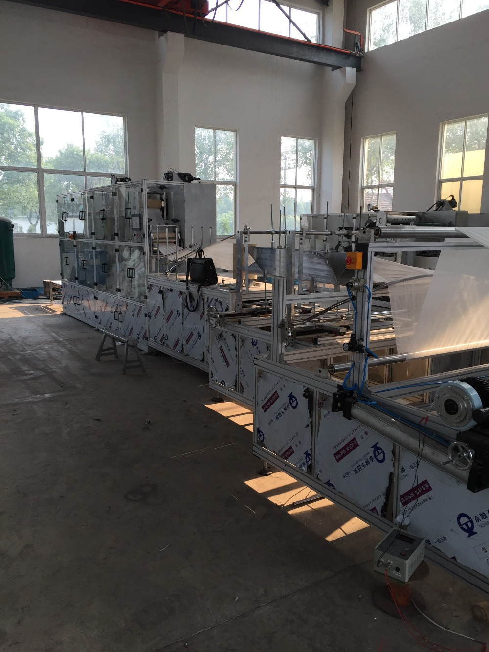 Disposable Bed Sheet Folding Machine