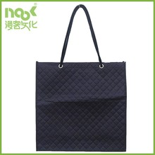 Rope handles through eyelets non woven bag with heat seal embossed surface