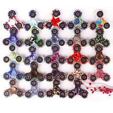 Hot selling fancy design customized pattern metal ball bearing tri finger fidget spinner for kids teens adults