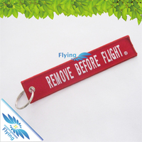 custom remove before flight brand logo fabric keychain for promotion 2016